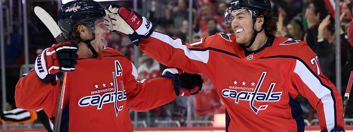 Washington Capitals right wing T.J. Oshie celebrates his goal with center Nicklas Backstrom during a game against the Ottawa Senators (Nick Wass)