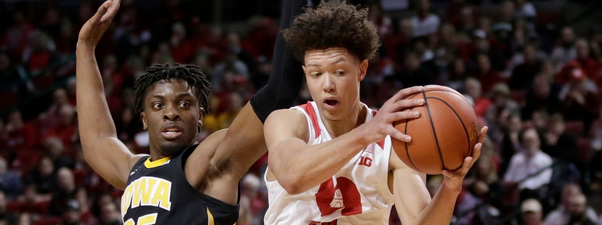 Nebraska's Isaiah Roby wins a rebound against Iowa's Tyler Cook during the first half of a game on March 10, 2019. (Nati Harnik)