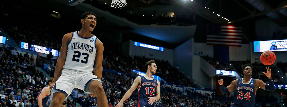 Villanova's Jermaine Samuels (23) screams after his dunk in the NCAA Tournament, Thursday, March 21, 2019, in Hartford, Conn. (AP Photo/Elise Amendola)