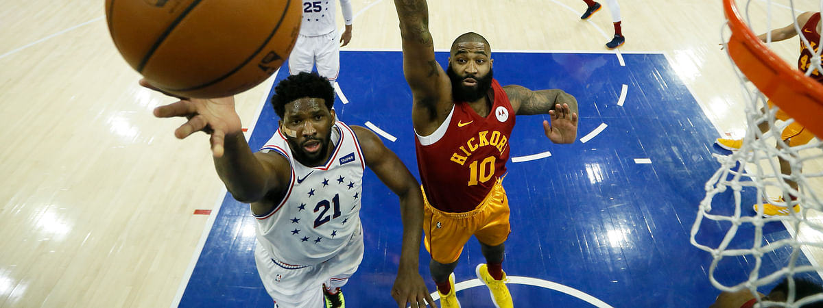 Philadelphia 76ers' Joel Embiid goes up for a shot past Indiana Pacers' Kyle O'Quinn during the game on March 10, 2019.