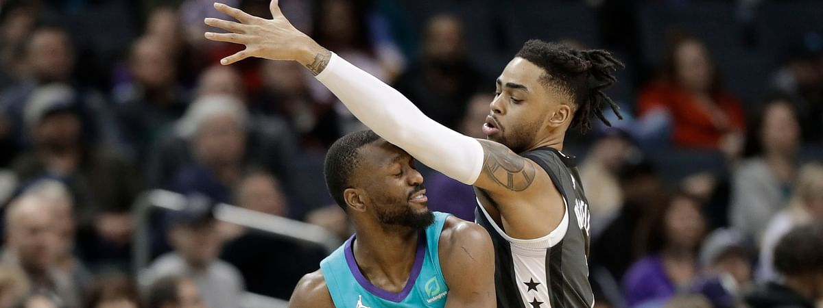 Brooklyn's D'Angelo Russell defends Charlotte's Kemba Walker in a Feb. 23 game (Chuck Burton)