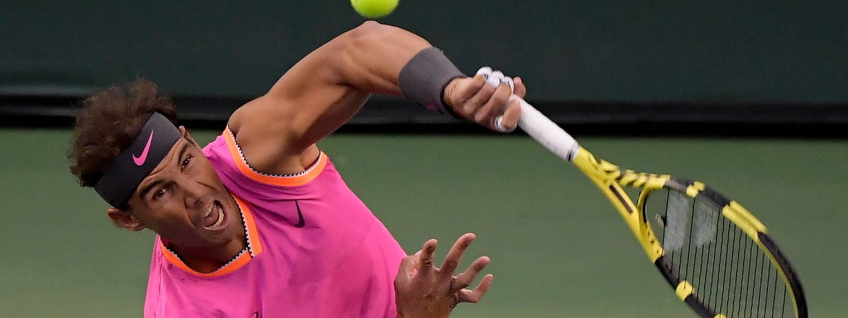 Rafael Nadal, of Spain, serves to Jared Donaldson at the BNP Paribas Open, Sunday, March 10, 2019, in Indian Wells, Calif. (AP Photo/Mark J. Terrill)