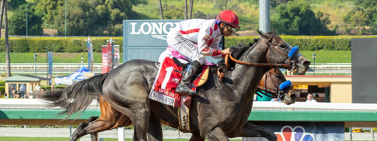 In this image provided by Benoit Photo, Roadster (1), with Mike Smith aboard, overpowers Game Winner, inside, with Joel Rosario aboard, to win the Grade I, $1,000,000 Santa Anita Derby horse race on April 6, 2019.
