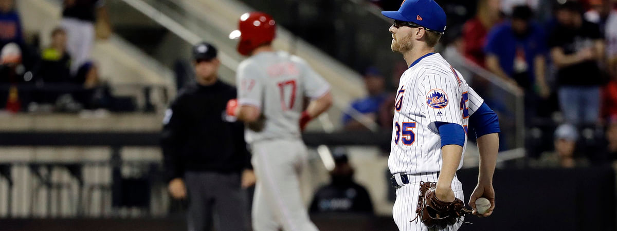 Mets  pitcher Jacob Rhame waits as Phillies' Rhys Hoskins casually circles the bases after a home run in the ninth inning April 24 (Frank Franklin II)