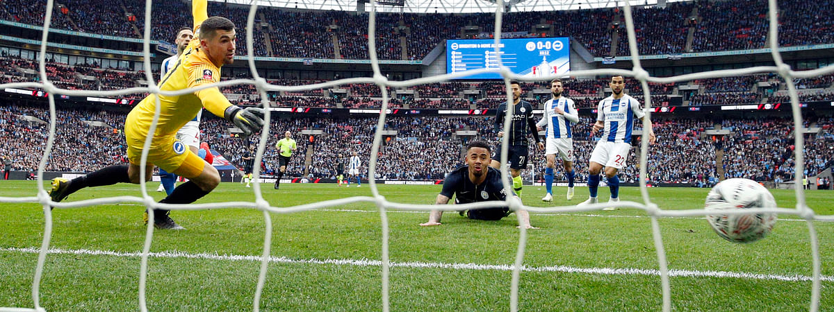 Manchester City's Gabriel Jesus scores the opening goal during the English FA Cup semifinal soccer match between Manchester City and Brighton & Hove Albion at Wembley Stadium on April 6, 2019.