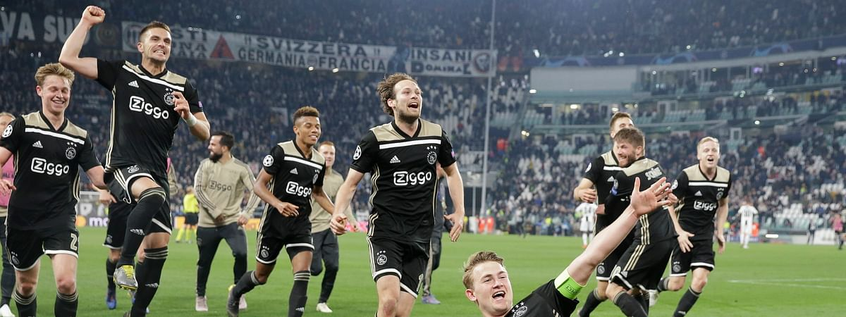Ajax's Matthijs de Ligt and teammates celebrate at the end of the Champions League, quarterfinal, second leg soccer match between Juventus and Ajax, at the Allianz stadium on Tuesday, April 16, 2019.