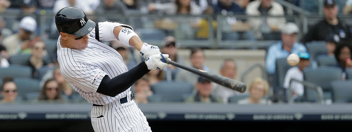 New York Yankees' Aaron Judge hits an RBI single during the third inning of a baseball game against the Chicago White Sox on April 14, 2019.