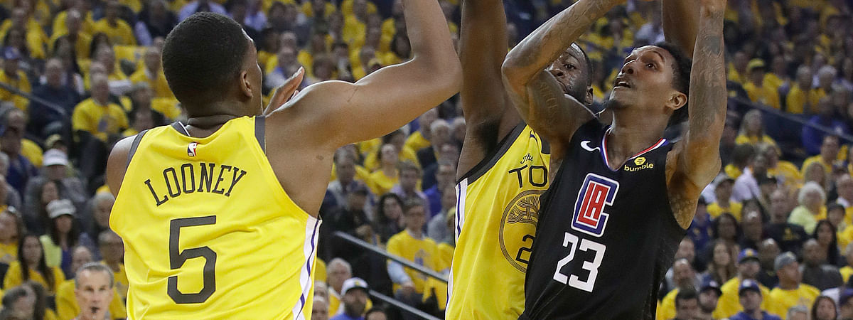 Los Angeles Clippers guard Lou Williams (23) shoots against Golden State Warriors center Kevon Looney (5) and forward Draymond Green during the  NBA basketball playoff series on Monday, April 15, 2019.