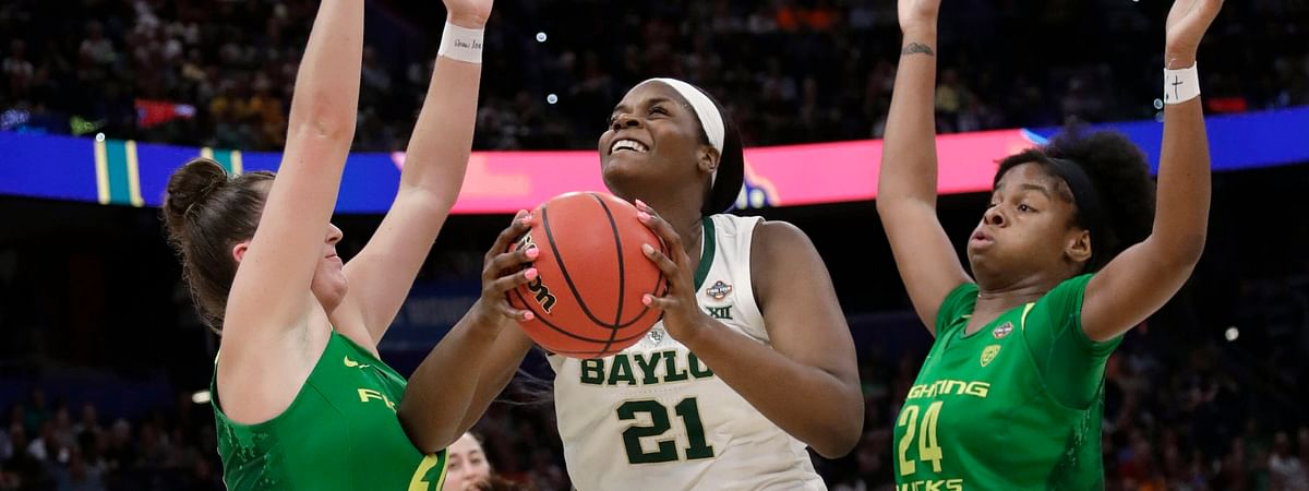 Baylor center Kalani Brown (21) looks for a shot between Oregon forwards Ruthy Hebard (24) and Erin Boley, left, during a Final Four semifinal of the NCAA women's college basketball tournament on April 5, 2019.