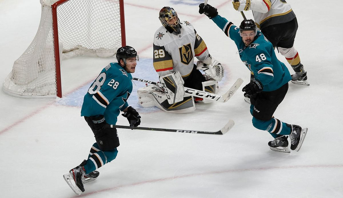 Sharks' Timo Meier (left) and Tomas Hertl celebrate a goal in Game 7 against the Golden Knights on April 23 (Jeff Chiu)