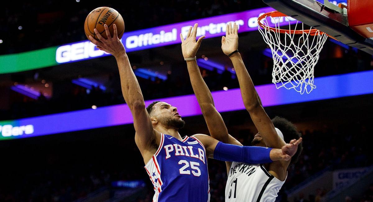 Philadelphia's  Ben Simmons goes up for a shot against the Nets' Jarrett Allen in Game 2 Monday (Chris Szagola)