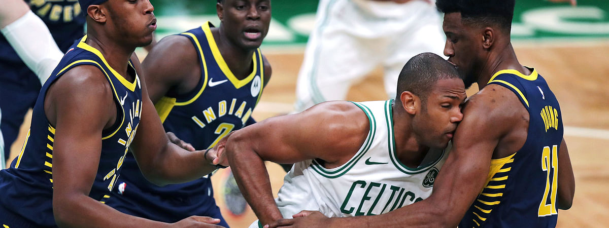 Boston Celtics center Al Horford, is trapped by Indiana Pacers forward Thaddeus Young during Game 2 on April 17 (Charles Krupa)
