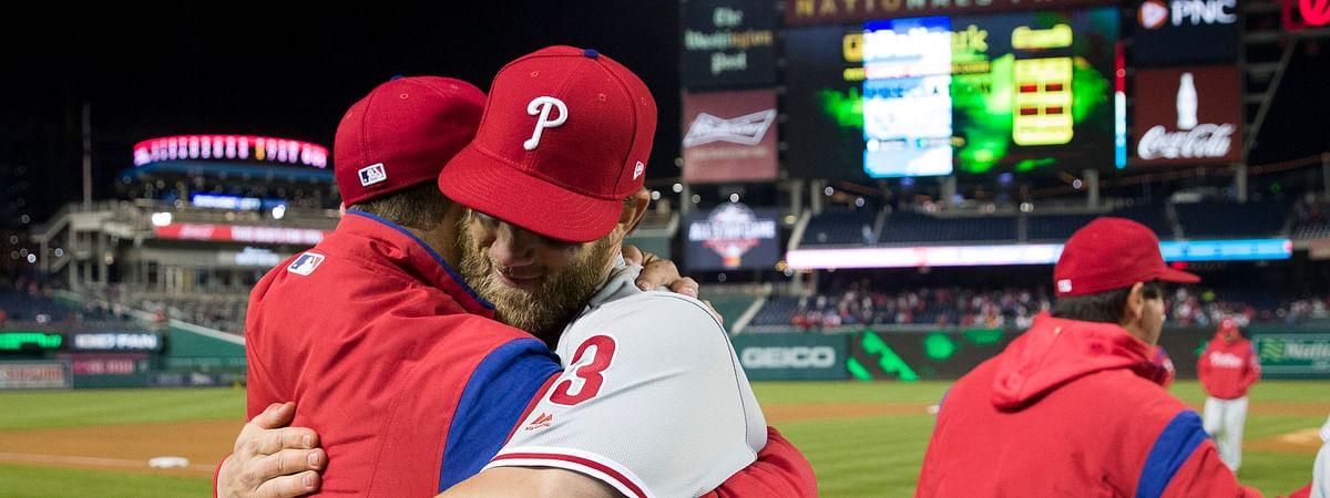 Phillies manger Gabe Kapler (left_ gets hugged by Bryce Harper after Tuesday's game (Alex Brandon)