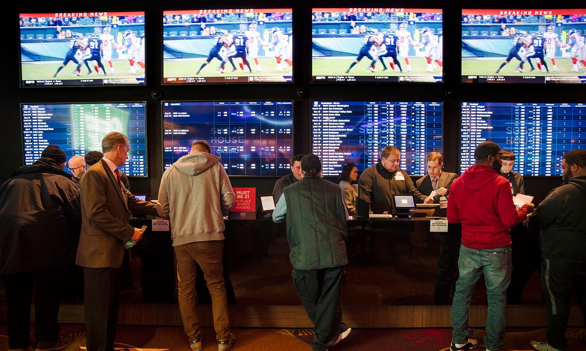 In this Dec. 13, 2018, file photo, gamblers place bets in the temporary sports betting area at the SugarHouse Casino (now Rivers) in Philadelphia.