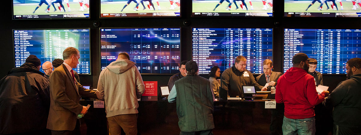 In this Dec. 13, 2018, file photo, gamblers place bets in the temporary sports betting area at the SugarHouse Casino in Philadelphia.