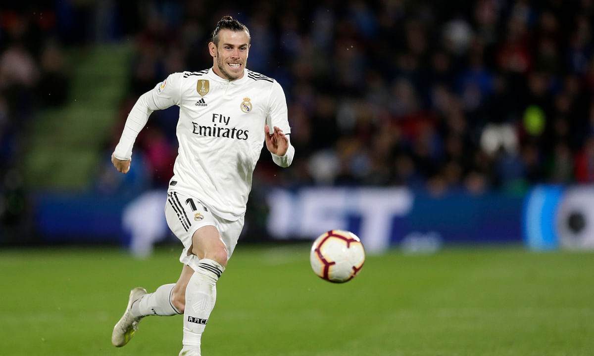 Real Madrid's Gareth Bale goes for the ball during a Spanish La Liga soccer match between Getafe and Real Madrid on April 25, 2019. Bale is on the Wales team playing against Finland today.