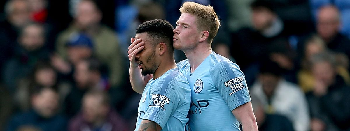 Manchester City's Gabriel Jesus, left, celebrates scoring his side's third goal of the game with teammate Kevin De Bruyne, during the English Premier League soccer match between Crystal Palace and Manchester City on April 14, 2019.