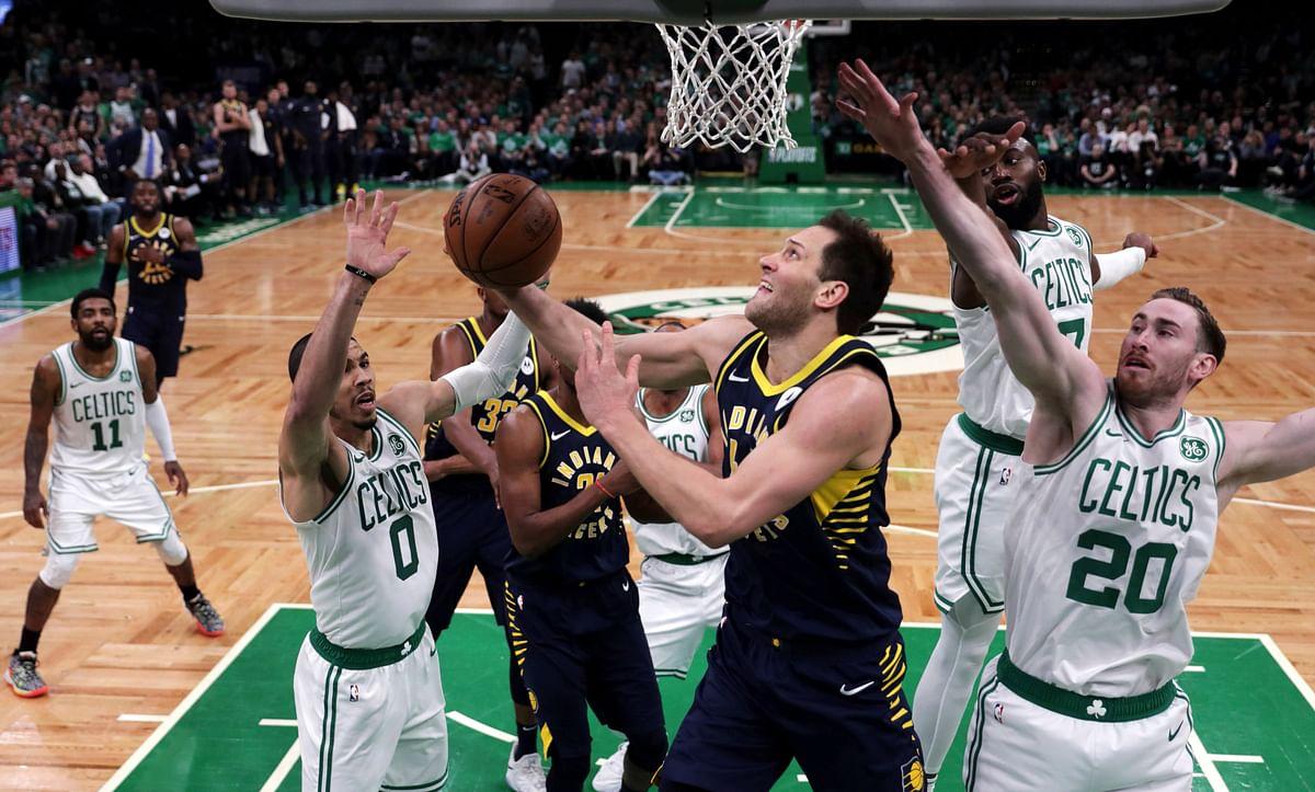 Indiana  forward Bojan Bogdanovic drives to the basket past a plethora of Boston Celtics in Game 2  April 17 (Charles Krupa)