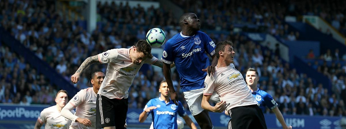 Manchester United's Victor Lindelof, left, and teammate Nemanja Matic battle for the ball with Everton's Kurt Zouma during the English Premier League soccer match on April 21, 2019.
