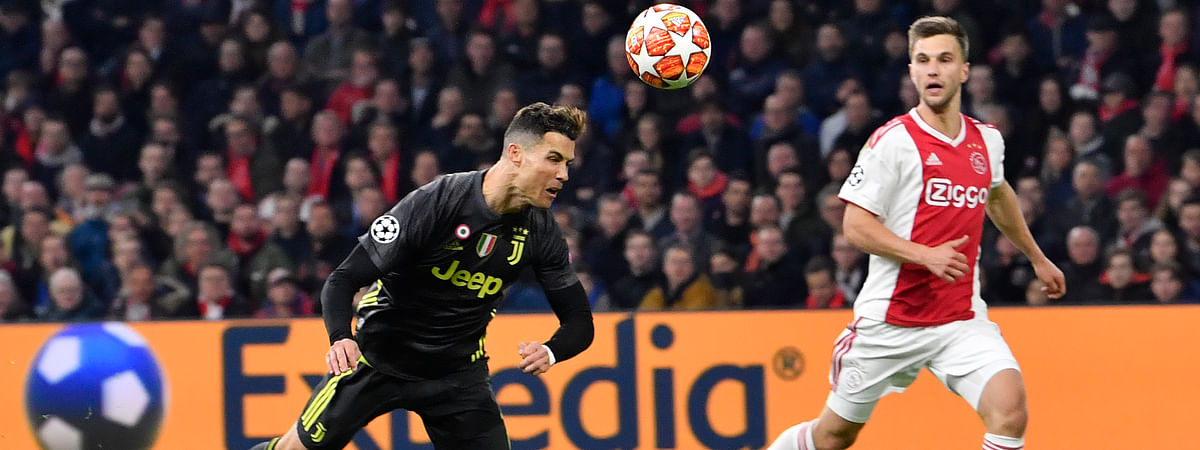 Juventus' Cristiano Ronaldo scores his side's opening goal during the Champions League quarterfinal, first leg, soccer match between Ajax and Juventus on April 10, 2019.