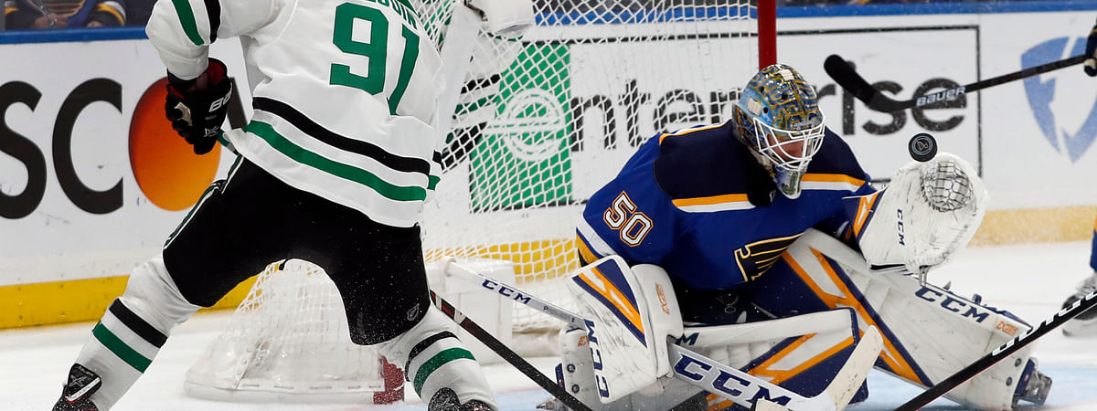 St. Louis Blues goaltender Jordan Binnington stops a shot from Dallas Stars' Tyler Seguin during the third period in Game 2 of an NHL second-round hockey playoff series on April 27, 2019.