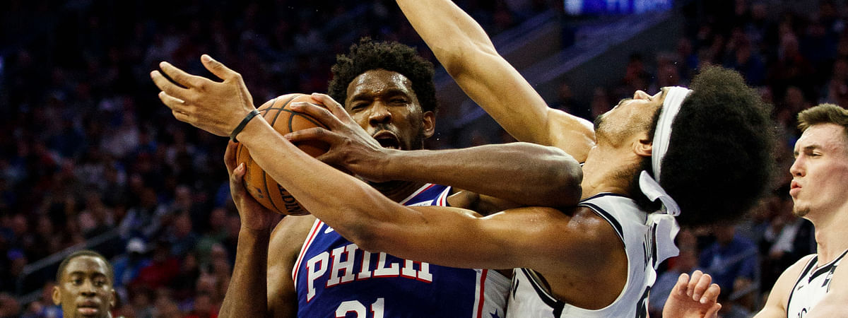 Philadelphia 76ers' Joel Embiid with the flagrant 1 foul on Brooklyn Nets' Jarrett Allen in Game 2 of a first-round NBA playoff series, April 15, 2019. (AP Photo/Chris Szagola)