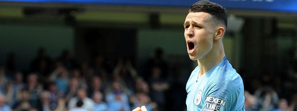 Manchester City's Phill Foden celebrates his goal against Tottenham during the English Premier League soccer match between Manchester City and Tottenham Hotspur at Etihad stadium in Manchester, England, Saturday, April 20, 2019. (AP Photo/Rui Vieira)