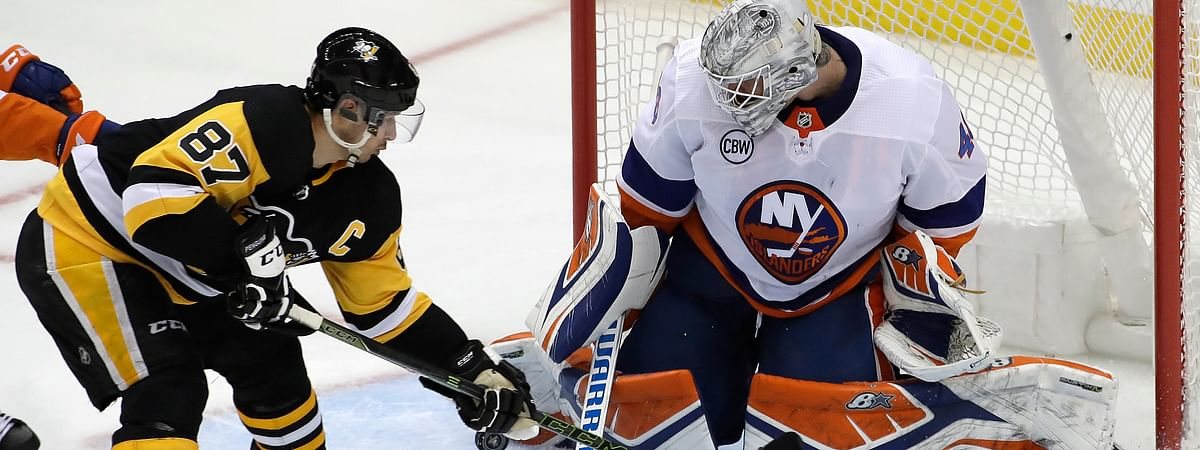 New York Islanders goaltender Robin Lehner stops a shot by Pittsburgh Penguins' Sidney Crosby during Game 3 of the NHL first-round hockey playoff series on April 14, 2019.