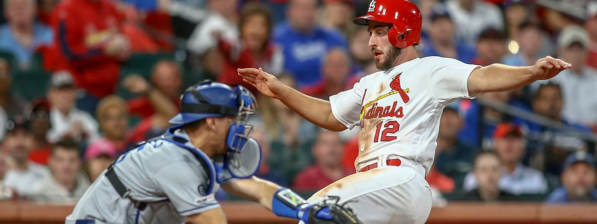 St. Louis Cardinals' Paul DeJong slides home to score next to Los Angeles Dodgers catcher Austin Barnes during the third inning of a baseball game on April 9, 2019.