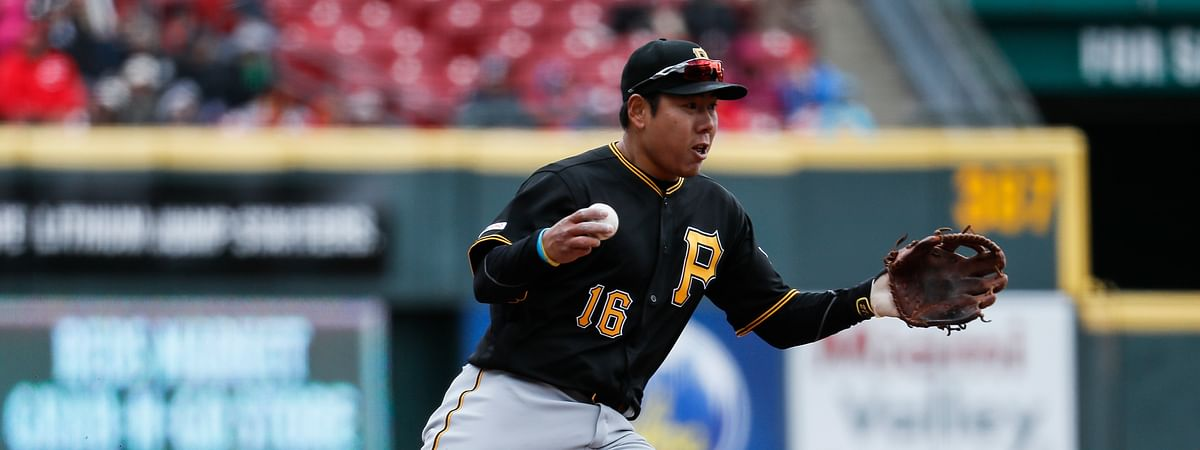 Pittsburgh Pirates shortstop Jung Ho Kang fields a single by Cincinnati Reds' Jose Iglesias in the game on March 31, 2019.
