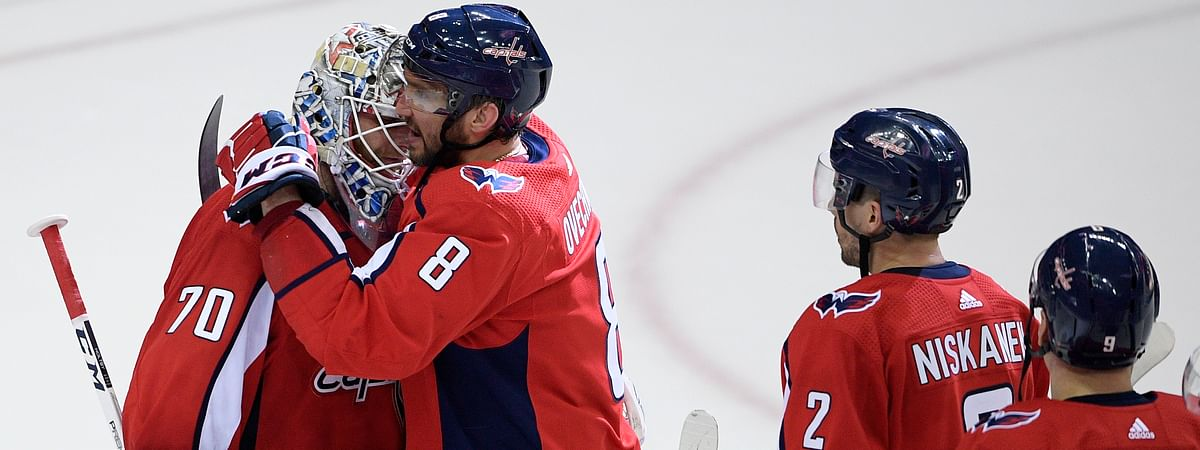 Capitals goalie Braden Holtby gets a hug from Alex Ovechkin. After tonight's game will he deserve a hug from Incarcerated Bob? (AP Photo/Nick Wass)