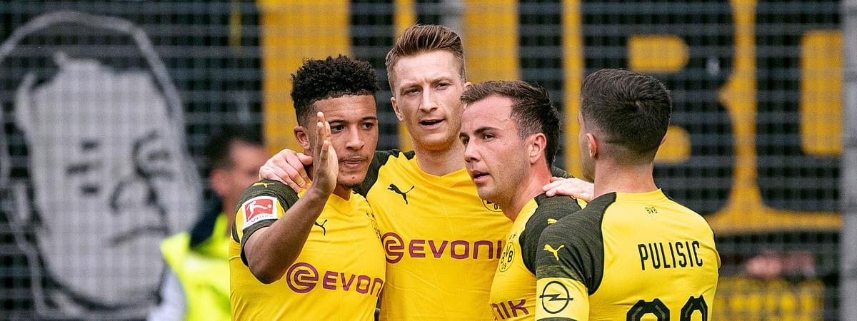 Dortmund's Jadon Sancho, Marco Reus, Mario Goetze and Christian Pulisic, from left, celebrate during the Bundesliga match against  SC Freiburg, Sunday, April 21, 2019. (Patrick Seeger/dpa via AP)