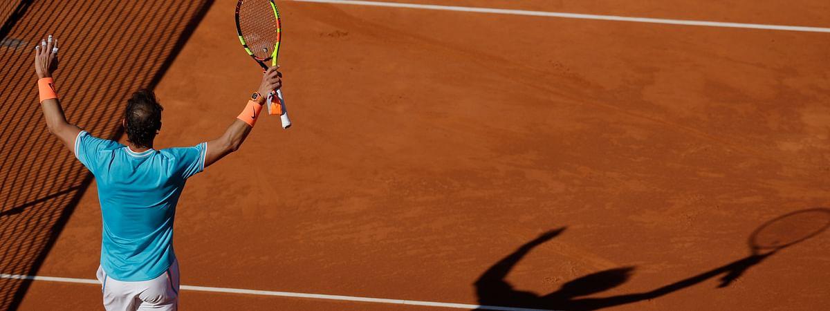 Rafael Nadal raises his racket after winning his match against Leonardo Mayer at the Barcelona Open , Wednesday, April 24, 2019. (AP Photo/Manu Fernandez)