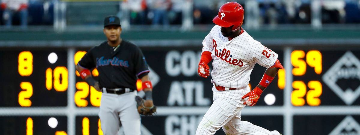 In this 2019 file photo, Phillies' Andrew McCutchen circles the bases after his fourth-inning home run.