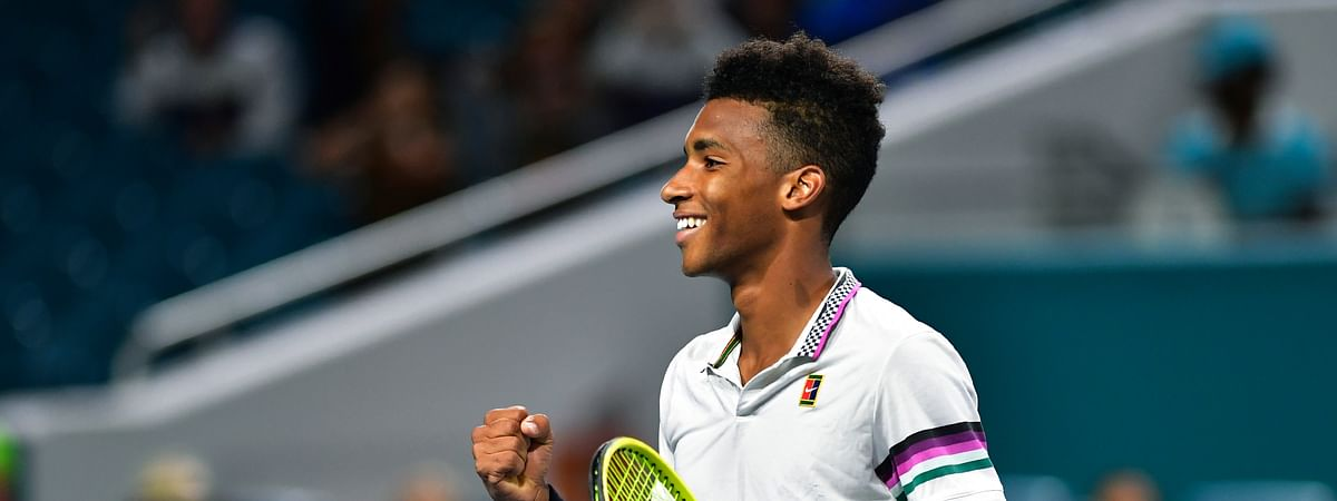 Felix Auger-Aliassime, of Canada, smiles after defeating Borna Coric, of Croatia, during the quarterfinals of the Miami Open tennis tournament Wednesday, March 27, 2019, in Miami Gardens, Fla. (AP Photo/Jim Rassol)