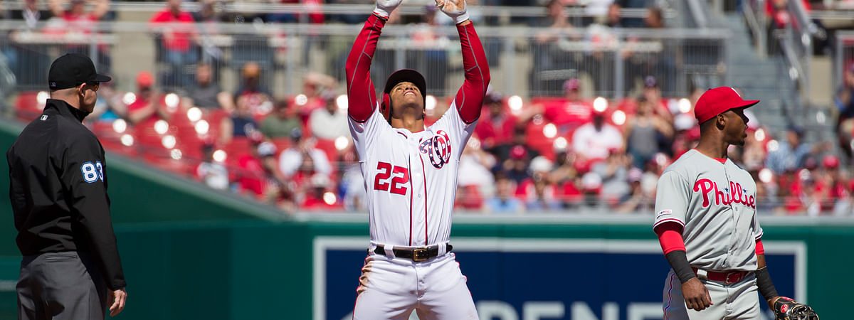 Washington Nationals' Juan Soto celebrates his hit for a double with Philadelphia Phillies shortstop Jean Segura covering second base on April 3, 2019.