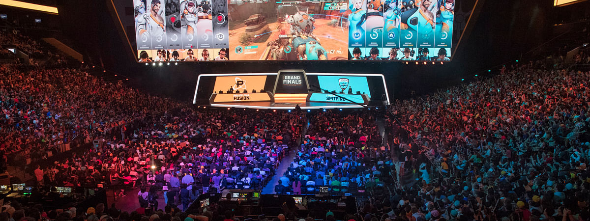 FILE - In this July 28, 2018, file photo, fans watch the competition between the Philadelphia Fusion and the London Spitfire during the Overwatch League Grand Finals, at Barclays Center in Brooklyn. (AP Photo/Mary Altaffer, File)