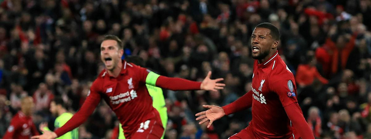 Liverpool's Georginio Wijnaldum, right, celebrates scoring his side's third goal of the game during the Champions League Semi Final, second leg soccer match between Liverpool and Barcelona at Anfield, Liverpool, England, Tuesday, May 7, 2019. (Peter Byrne/PA via AP)