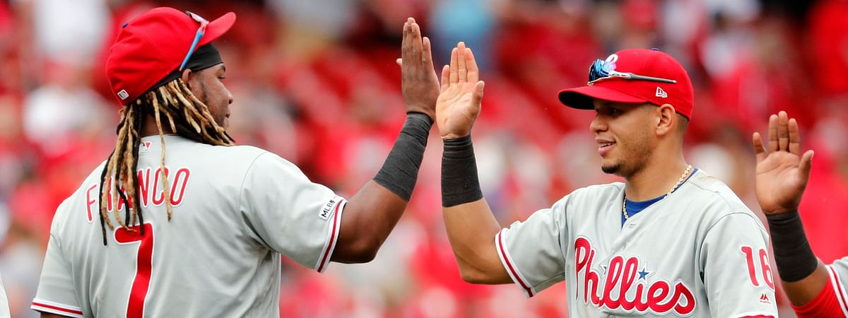 Phillies' Maikel Franco (left) and Cesar Hernandez  celebrate a victory over the  Cardinals May 8 (Jeff Roberson)