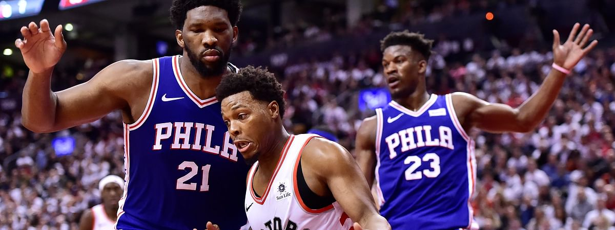 Toronto Raptors guard Kyle Lowry drives around Philadelphia 76ers center Joel Embiid during second-half, second-round NBA basketball playoff action on April 29, 2019.