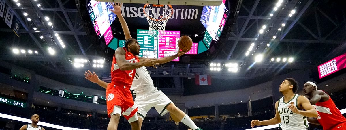 Toronto Raptors' Kawhi Leonard shoots past Milwaukee Bucks' Brook Lopez during the second half of Game 5 of the NBA Eastern Conference basketball playoff finals Thursday, May 23, 2019, in Milwaukee. The Raptors won 105-99 to take a 3-2 lead in the series. (AP Photo/Morry Gash)