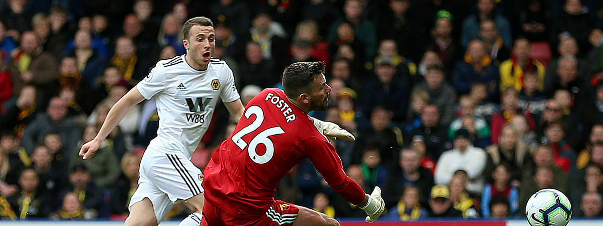 Wolverhampton Wanderers' Diogo Jota scores his side's second goal of the game during their English Premier League soccer match against Watford at Watford, Saturday, April 27, 2019. (Nigel French/PA via AP)