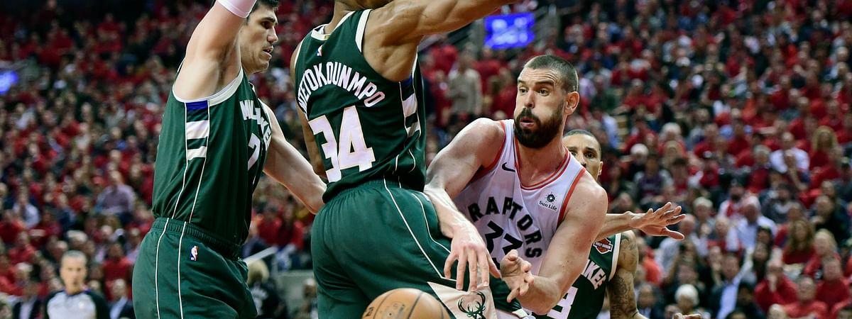 Toronto Raptors center Marc Gasol moves the ball pass Milwaukee Bucks forward Giannis Antetokounmpo during the second half of Game 4 of the Eastern Conference finals on May 21, 2019.