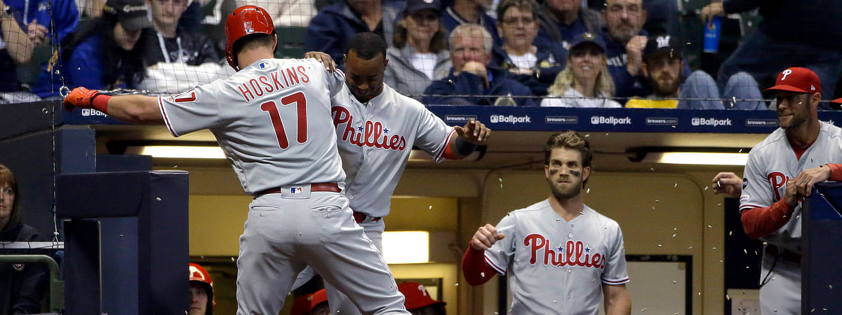 Phillies' Rhys Hoskins (17) and  Jean Segura celebrate  after Hoskins solo home run on May 24 (Aaron Gash)