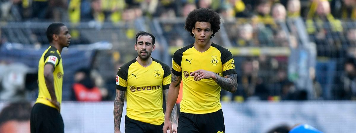 Dortmund's Axel Witsel and Dortmund's Paco Alcacer leave the pitch disappointed after losing the German Bundesliga soccer match between Borussia Dortmund and FC Schalke 04, Saturday, April 27, 2019.  (AP Photo/Martin Meissner)