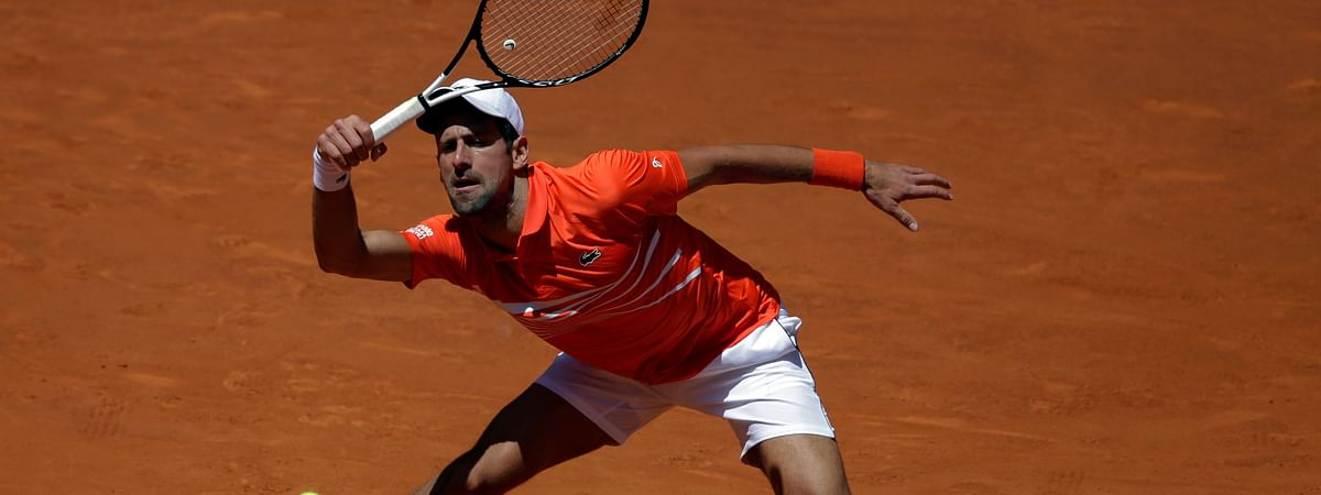 Novak Djokovic, of Serbia, returns the ball during his match against Jeremy Chardy, of France, during the Madrid Open tennis tournament on May 9, 2019.
