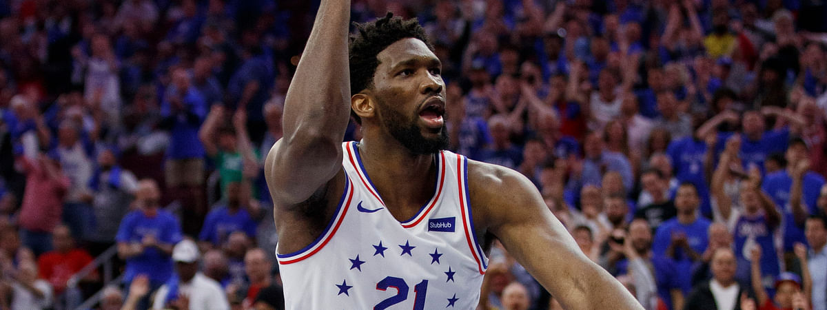 Philadelphia 76ers' Joel Embiid reacts to his dunk during the second half of Game 3 of the team's second-round NBA basketball playoff series against the Toronto Raptors on May 2, 2019.