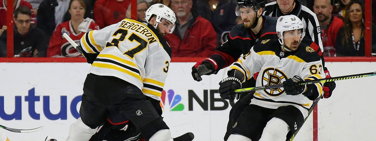 Bruins' Patrice Bergeron (37) and Brad Marchand look for the  puck in Game 3 on May 14 (Gerry Broome)