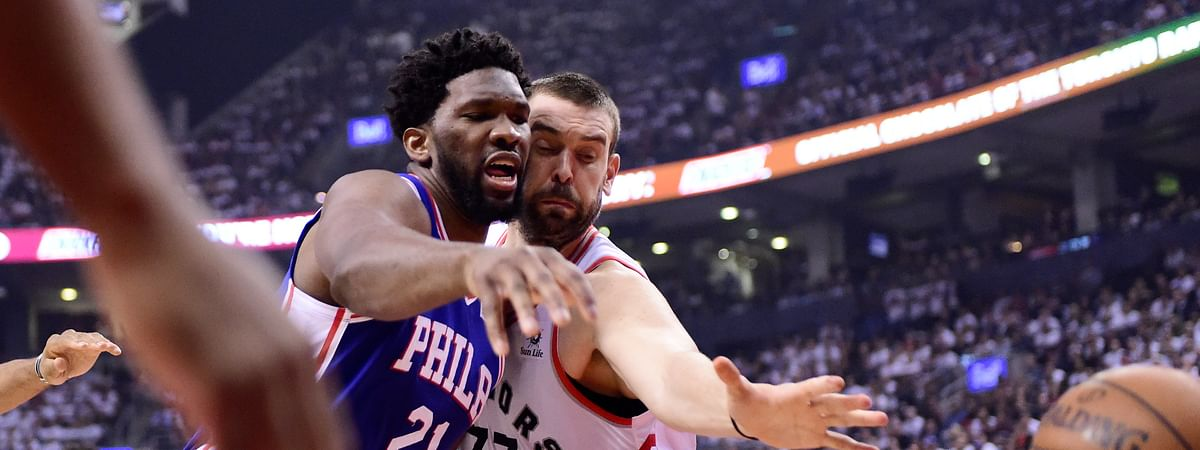 Philadelphia 76ers center Joel Embiid and Toronto Raptors center Marc Gasol watch the ball get away during the first half of Game 5 of an NBA basketball second-round playoff series on May 7, 2019.