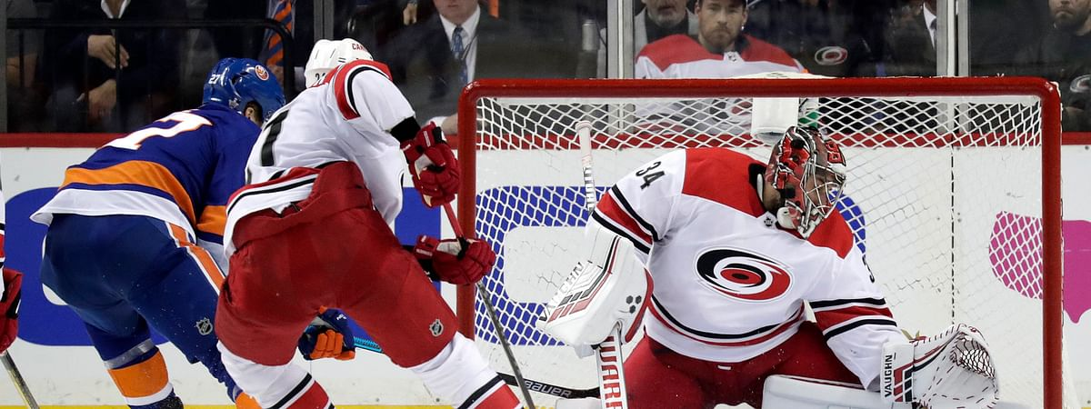Hurricanes goalie Petr Mrazek (shown making a save against the Islanders on April 26) is injured and unlikely to start in Game 3 on May 1 (Julio Cortez)